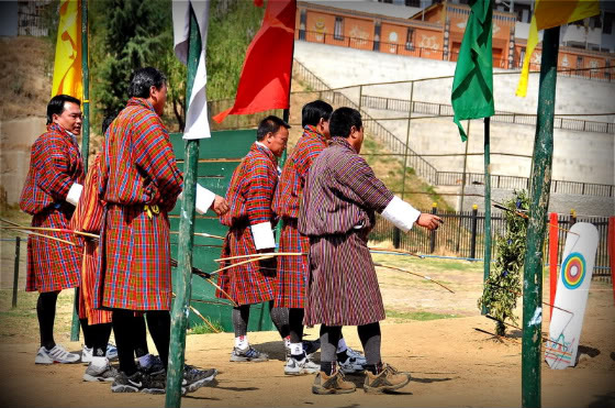 Bhutan: Men In Skirts Shooting Arrows